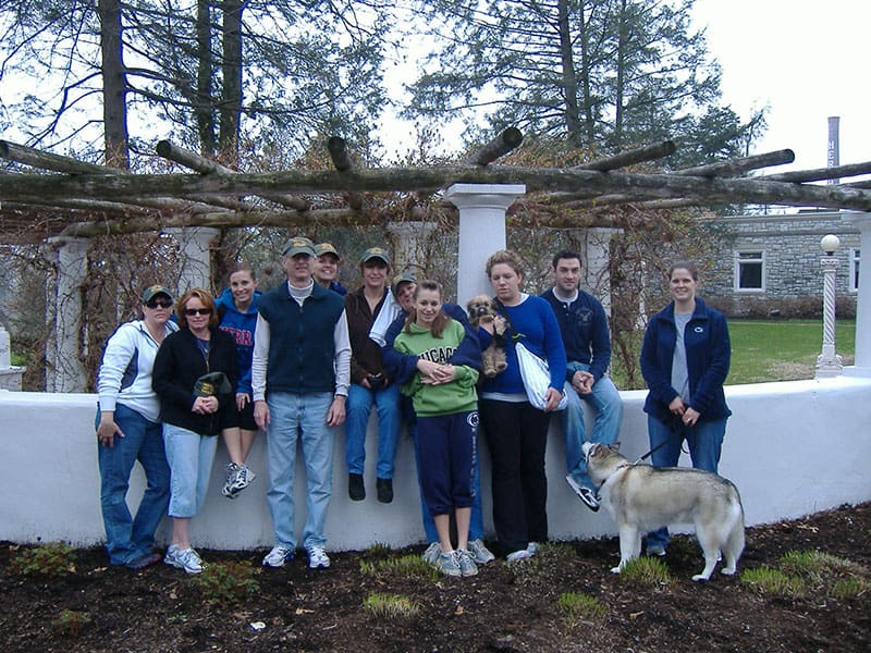 group of 11 people with two dogs