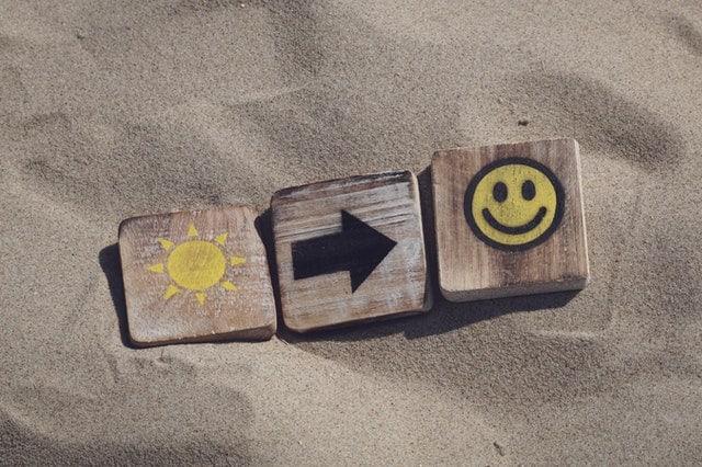 happy sun blocks in the sand